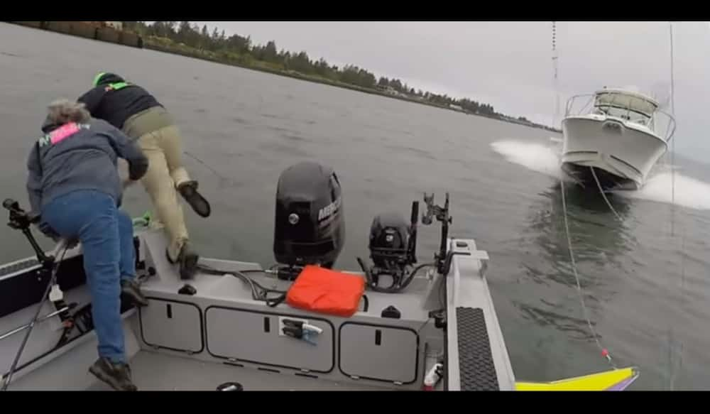 Fishermen Dive Into Water Seconds Before A Speedboat Almost Kills Them